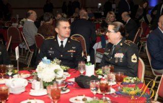 Two military veterans talking over dinner