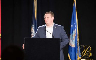 Gentleman speaking behind podium