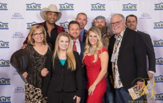 Willie Robertson and Coffey Anderson with group of people at gala
